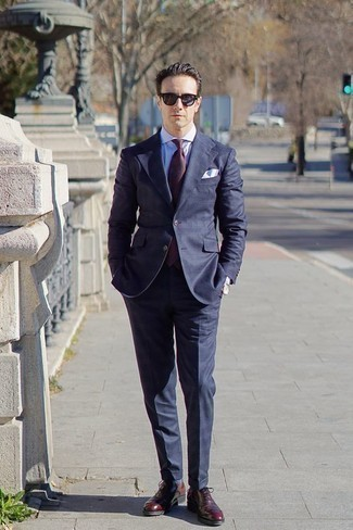 How to Wear a Navy Suit: You'll be surprised at how extremely easy it is to get dressed like this. Just a navy suit paired with a white dress shirt. A pair of burgundy leather oxford shoes serves as the glue that will bring your getup together.