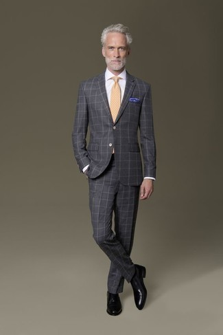 Men's Looks & Outfits: What To Wear In 2020: A charcoal check suit and a white dress shirt are essential in a refined man's closet. All you need is a cool pair of black leather oxford shoes to complete your ensemble.