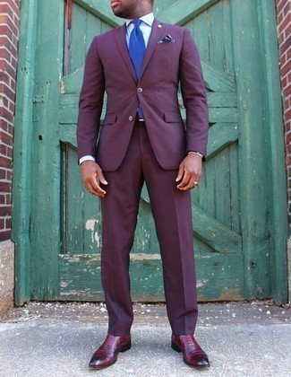 How to Wear a Violet Suit: A violet suit and a white dress shirt are a refined combo that every modern gent should have in his sartorial arsenal. Burgundy leather oxford shoes pull the look together.