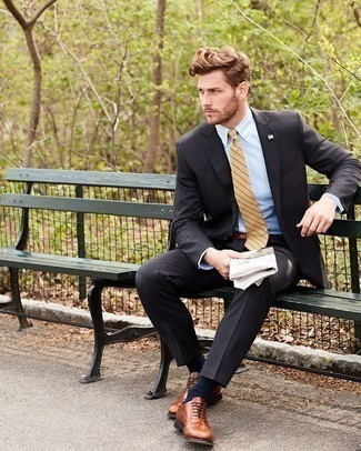 How to Wear a Charcoal Suit: For an outfit that's absolutely envy-worthy, marry a charcoal suit with a light blue dress shirt. This look is rounded off perfectly with a pair of brown leather oxford shoes.