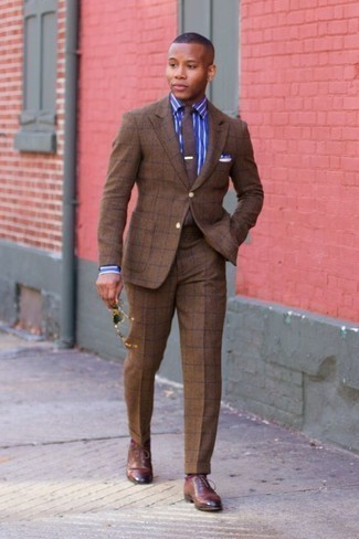 Fashion for 20 Year Old Men: What To Wear In a Dressy Way: Make an eye-catching statement anywhere you go in a brown check suit and a blue vertical striped dress shirt. A pair of brown leather oxford shoes immediately boosts the classy factor of any look. A good example for gents looking to shift their style towards maturity.