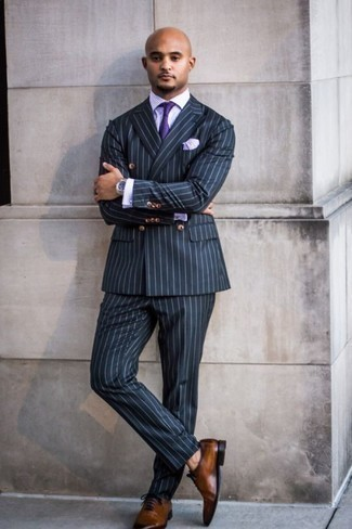 Violet Tie Outfits For Men: A navy vertical striped suit and a violet tie are among the unshakeable foundations of a classy wardrobe. Finishing off with a pair of brown leather oxford shoes is a fail-safe way to add an element of stylish effortlessness to your ensemble.