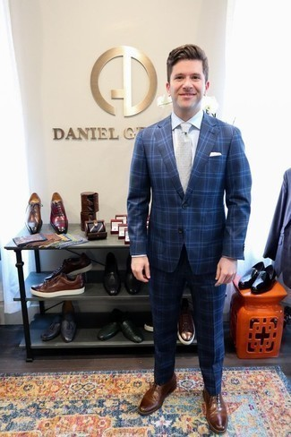 Grey Tie Outfits For Men: A blue plaid suit looks so elegant when married with a grey tie in a modern man's combination. Does this getup feel all-too-polished? Enter a pair of brown leather oxford shoes to switch things up.