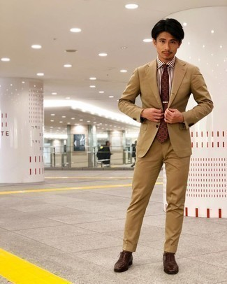 Brown Socks Outfits For Men: A tan suit and brown socks combined together are a match made in heaven for those dressers who love laid-back styles. Complement this ensemble with a pair of dark brown leather oxford shoes to make the look slightly sleeker.