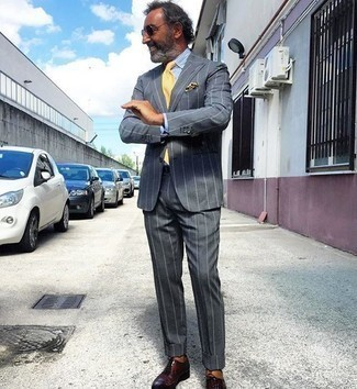 Yellow Tie Outfits For Men: Marrying a charcoal vertical striped suit and a yellow tie is a guaranteed way to inject your closet with some manly refinement. A pair of burgundy leather oxford shoes will add a mellow touch to your ensemble.