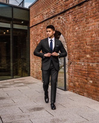 Gold Watch Outfits For Men: This combo of a black suit and a gold watch will be definitive proof of your expertise in men's fashion even on weekend days. Black leather oxford shoes are an effortless way to inject an added dose of style into your look.