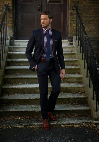 How to Wear a Red and Navy Gingham Dress Shirt For Men: You're looking at the definitive proof that a red and navy gingham dress shirt and a black suit are amazing when paired together in a sophisticated getup for today's gent. On the shoe front, this look is rounded off perfectly with brown leather oxford shoes.