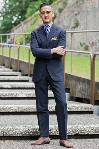 Navy and White Polka Dot Tie Outfits For Men: For an ensemble that's smart and camera-worthy, consider teaming a navy suit with a navy and white polka dot tie. For a more relaxed aesthetic, why not complete this ensemble with a pair of brown suede oxford shoes?