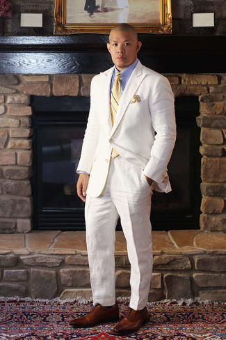Yellow Horizontal Striped Tie Outfits For Men: Dapper up in a white suit and a yellow horizontal striped tie. If you want to easily dress down this look with a pair of shoes, introduce a pair of brown leather oxford shoes to the equation.