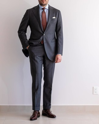 Charcoal Suit Outfits: A charcoal suit and a light blue dress shirt are a smart combo that will get you a ton of attention. Dark brown leather oxford shoes are a smart choice to round off this ensemble.