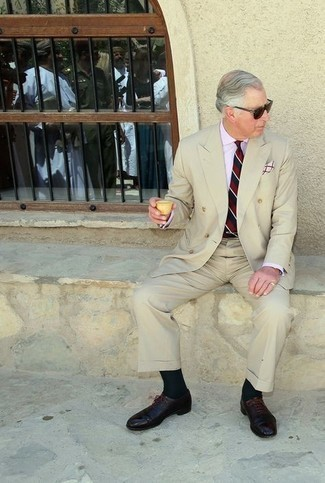 500+ Outfits For Men After 60: Loving the way this pairing of a beige suit and a light blue dress shirt instantly makes a man look elegant and stylish. Add a pair of dark brown leather oxford shoes to the mix and off you go looking boss. As a middle-aged guy, you're sure to like this look.