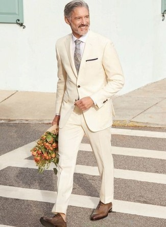 Tie Outfits For Men: Putting together a beige suit and a tie is a guaranteed way to infuse your day-to-day styling rotation with some rugged sophistication. In the footwear department, go for something on the casual end of the spectrum by slipping into brown leather oxford shoes.