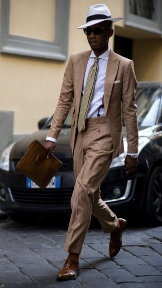 Suspenders Outfits: Combining a tan vertical striped suit with suspenders is a great pick for a casual and cool outfit. Why not introduce a pair of brown leather oxford shoes to the equation for an added dose of style?