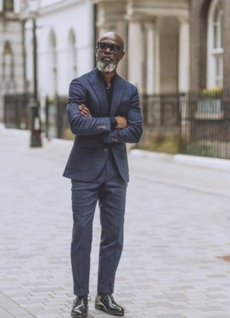 Black Leather Oxford Shoes Outfits: Go for a navy vertical striped suit and a black dress shirt if you're aiming for a clean, stylish ensemble. Now all you need is a good pair of black leather oxford shoes.