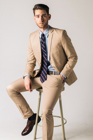 Navy Horizontal Striped Tie Outfits For Men: A tan suit and a navy horizontal striped tie are a good combination that will earn you a great deal of attention. Wondering how to finish off? Add dark brown leather oxford shoes to the mix to switch things up.