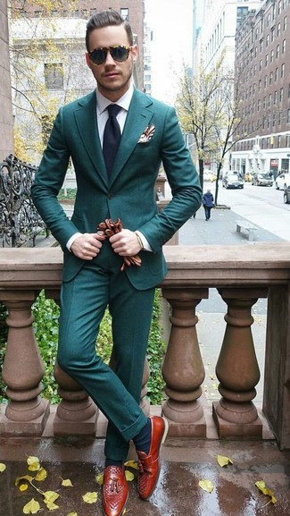 How to wear: teal suit, white dress shirt, tobacco leather tassel loafers, navy tie