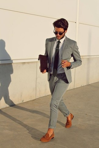 How to wear: grey suit, white dress shirt, tobacco suede tassel loafers, dark brown leather zip pouch