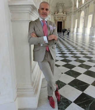 How to wear: grey suit, light blue dress shirt, red leather tassel loafers, pink tie
