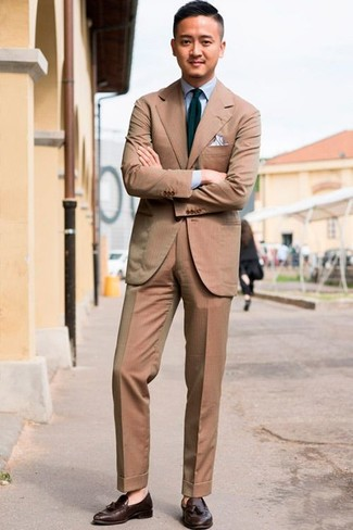 How to wear: tan suit, light blue dress shirt, dark brown leather tassel loafers, navy and green vertical striped tie