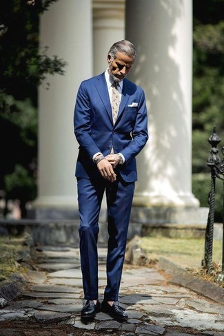 How to wear: blue suit, white dress shirt, black leather tassel loafers, beige floral tie