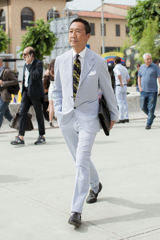How to wear: light blue seersucker suit, white dress shirt, black leather tassel loafers, black leather briefcase