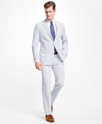 How to wear: white seersucker suit, white dress shirt, brown suede tassel loafers, blue polka dot tie