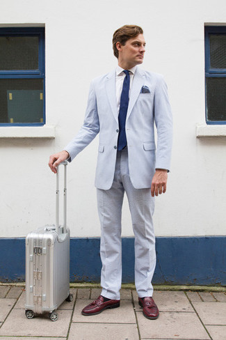 How to wear: light blue seersucker suit, white dress shirt, burgundy leather tassel loafers, navy tie