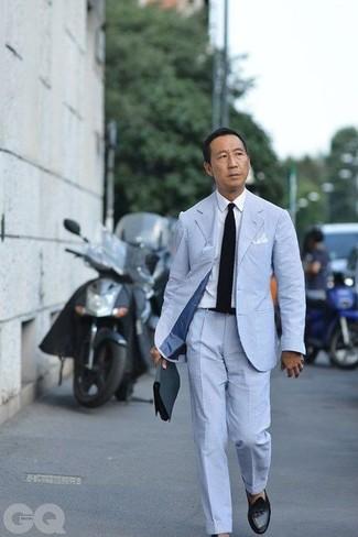 How to wear: light blue seersucker suit, white dress shirt, black leather tassel loafers, black knit tie