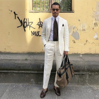 How to wear: white linen suit, white vertical striped dress shirt, dark brown leather tassel loafers, brown canvas holdall