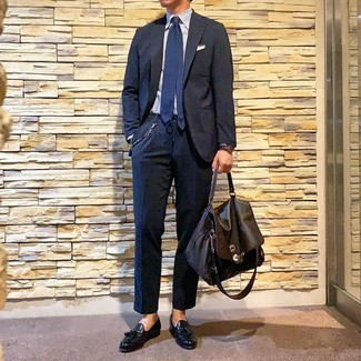 How to wear: navy suit, light blue vertical striped dress shirt, black leather tassel loafers, dark brown leather briefcase