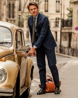 How to wear: navy vertical striped suit, light blue chambray dress shirt, dark brown leather tassel loafers, tobacco leather holdall