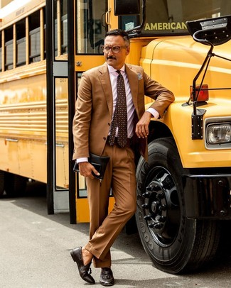 How to wear: tan suit, pink vertical striped dress shirt, dark brown leather tassel loafers, black leather zip pouch