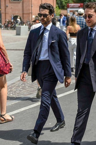 Men's Looks & Outfits: What To Wear In 2020: This combo of a navy suit and a white vertical striped dress shirt is seriously dapper and provides a clean and crisp look. Black leather tassel loafers complete this look quite nicely.