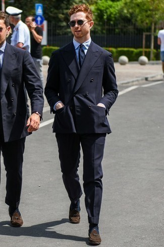 Men's Looks & Outfits: What To Wear In 2020: You're looking at the solid proof that a black suit and a light blue vertical striped dress shirt look amazing when paired together in a sophisticated ensemble for today's man. A pair of dark brown suede tassel loafers is a nice pick to finish off this look.