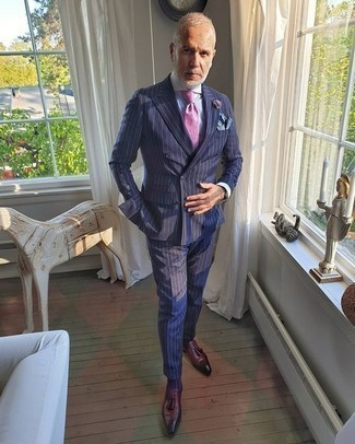 How to Wear a Blue Pocket Square: This combination of a navy vertical striped suit and a blue pocket square is pulled together and yet it looks casual and apt for anything. Introduce burgundy leather tassel loafers to the equation for a masculine aesthetic.