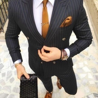 How to Wear a Black Vertical Striped Suit: Combining a black vertical striped suit with a white dress shirt is an on-point pick for a classic and elegant ensemble. Look at how nice this outfit goes with a pair of tobacco leather tassel loafers.