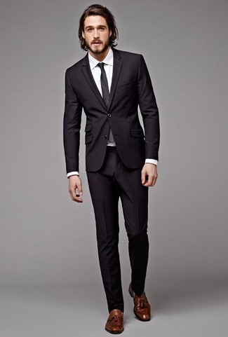 How To Wear a Black Suit With Brown Shoes: A black suit and a white dress shirt are absolute must-haves if you're piecing together a classy closet that matches up to the highest sartorial standards. Complete your ensemble with a pair of brown leather tassel loafers to easily step up the street cred of this ensemble.