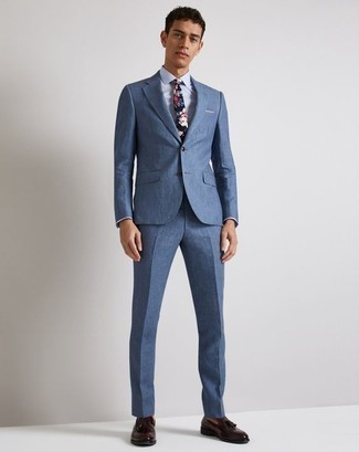 How to Wear Burgundy Leather Tassel Loafers: A blue suit and a light blue dress shirt are absolute mainstays if you're piecing together a sharp closet that holds to the highest men's style standards. Burgundy leather tassel loafers will immediately dress down an all-too-perfect getup.