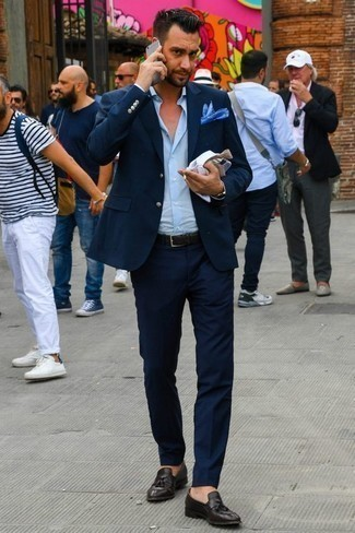 Men's Looks & Outfits: What To Wear In Summer: A navy suit looks so refined when married with a light blue dress shirt for a look worthy of a complete gent. Bring a more casual twist to by slipping into dark brown leather tassel loafers. This outfit has all the elements of your summer uniform.