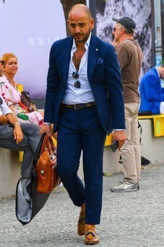 How to Wear Tobacco Leather Tassel Loafers: A navy suit and a light blue vertical striped dress shirt are absolute mainstays if you're putting together a refined wardrobe that matches up to the highest men's style standards. Tobacco leather tassel loafers are a fitting idea here.