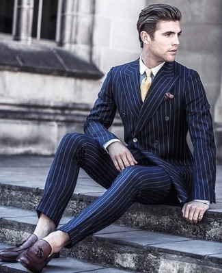 How to Wear a Burgundy Pocket Square: You're looking at the irrefutable proof that a navy vertical striped suit and a burgundy pocket square look awesome when combined together in a casual look. You could perhaps get a bit experimental on the shoe front and complete your look with burgundy leather tassel loafers.