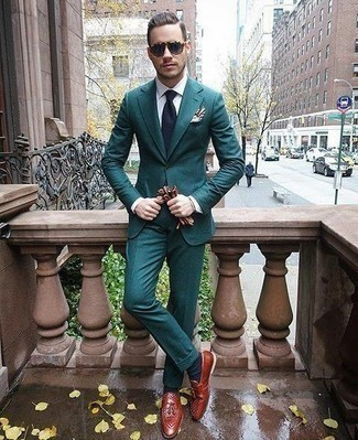 How to Wear Tobacco Leather Tassel Loafers: This is indisputable proof that a teal suit and a white dress shirt are awesome when combined together in a sophisticated look for today's gentleman. Finishing off with tobacco leather tassel loafers is a surefire way to infuse a laid-back vibe into this look.