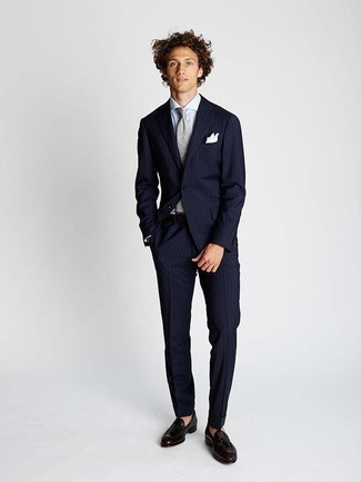 Fashion for 20 Year Old Men: What To Wear: For a look that's refined and wow-worthy, opt for a navy vertical striped suit and a white dress shirt. The whole getup comes together really well if you add dark brown leather tassel loafers to the mix. Wear this pairing when you need to present a more sophisticated image as a 20-something gent.