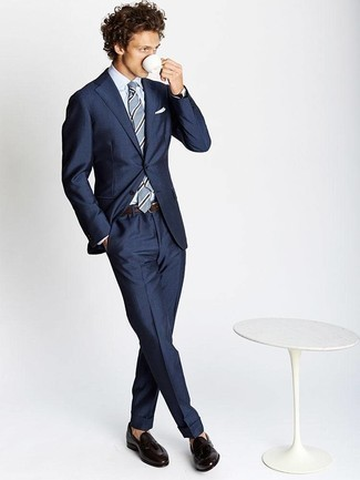 Fashion for 20 Year Old Men: What To Wear: A navy suit and a white dress shirt are an elegant combination that every modern gentleman should have in his collection. When this ensemble is just too much, dress it down by wearing dark brown leather tassel loafers. Wondering how you should dress in your 20s? This getup is an amazing example.