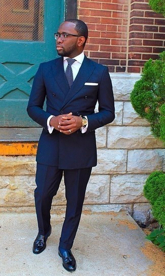 Men's Looks & Outfits: What To Wear In 2020: Choose a navy suit and a white dress shirt and you're guaranteed to make a statement. Complete your outfit with a pair of black leather tassel loafers to infuse an air of stylish effortlessness into this outfit.
