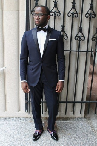 How to Wear a White Pocket Square: For a look that's very straightforward but can be manipulated in plenty of different ways, dress in a navy suit and a white pocket square. Let your outfit coordination expertise really shine by complementing this ensemble with a pair of black leather tassel loafers.