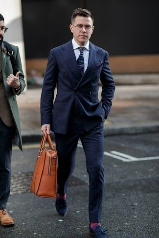 How to Wear a Navy Vertical Striped Suit: Consider pairing a navy vertical striped suit with a white dress shirt to look like a true style maverick. Add navy suede tassel loafers to the mix and off you go looking smashing.