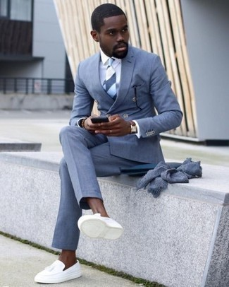 How to Wear a Light Blue Suit: A light blue suit and a white dress shirt are a polished outfit that every modern gentleman should have in his sartorial collection. Inject a mellow feel into your ensemble by wearing a pair of white canvas tassel loafers.