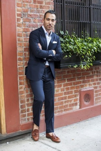 How to Wear Brown Leather Tassel Loafers: This sophisticated pairing of a navy suit and a white dress shirt will allow you to demonstrate your sartorial prowess. Go off the beaten track and jazz up your ensemble by finishing off with brown leather tassel loafers.