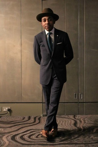 How to Wear a Hat For Men: Display your prowess in men's fashion by marrying a dark brown suit and a hat for a casual combo. And if you need to effortlessly polish up this outfit with footwear, introduce a pair of tan leather tassel loafers to your look.